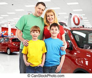 Happy family near new car.