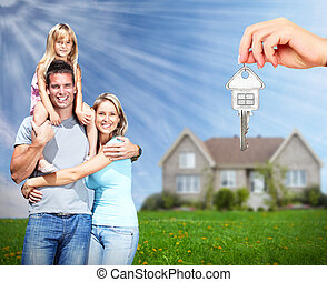 Happy family near new home. Real estate background.