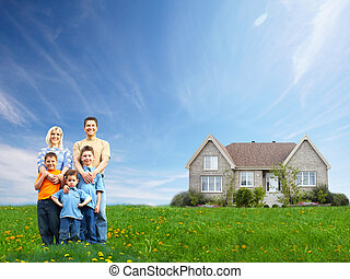Happy family near new house. Real estate.