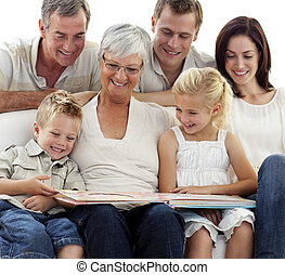 Happy family observing photograph album