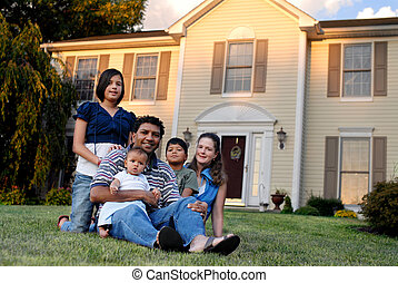 Happy Family of Five - A mixed-race family on the front lawn...