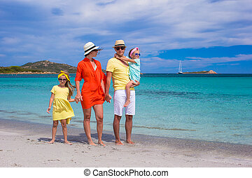 Happy family of four during summer vacation