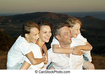 family of four people - happy family of four people in a...