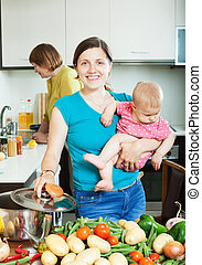 Happy family of three generations together cooking in the...