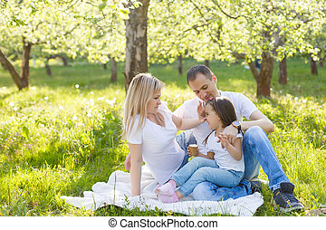Happy family of three having fun in the park