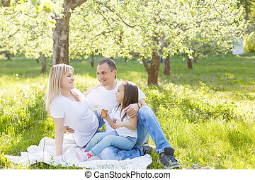 Happy family of three having fun in the park