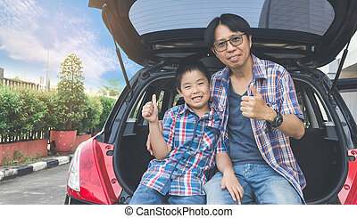 Happy family on a road trip, Sitting In Trunk Of Car