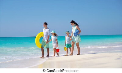 Happy family on a tropical beach