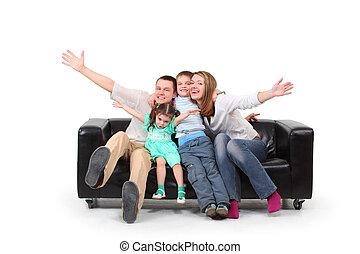 Happy family on black leather sofa