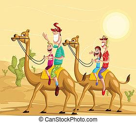Happy family on camel ride in desert
