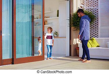 happy family on cozy patio area with sliding doors