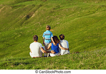 Happy family on nature in summer