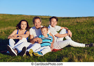 Happy family on nature in summer.