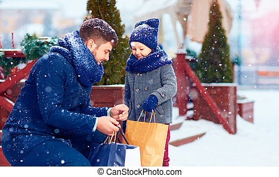 happy family on shopping in winter city