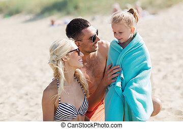 happy family on summer beach