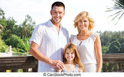 happy family on summer vacation at resort beach