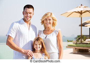 happy family on summer vacation at resort beach