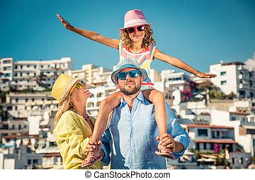 Happy family on summer vacation