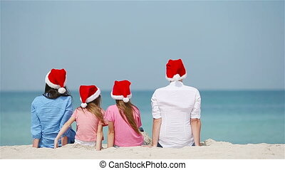 Happy family on the beach celebrating Christmas vacation