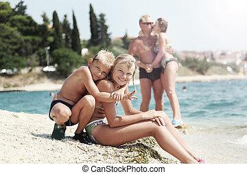 Happy family on the beach