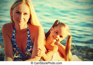 happy family on the beach. mother and baby daughter