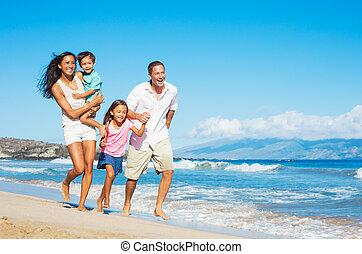 Happy Family on the Beach - Happy Mixed Race Family of Four...