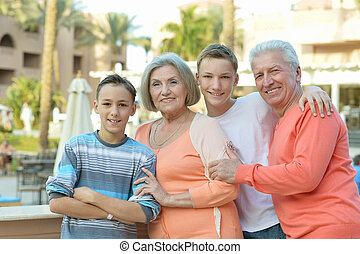 Happy family on tropical resort