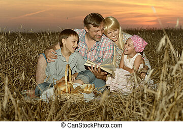 Happy family on wheat field