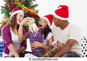 happy family opening Christmas gift