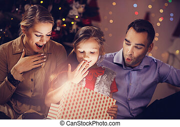 Happy Family Opening Christmas Present