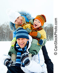 happy family outdoor - happy young family spending time...