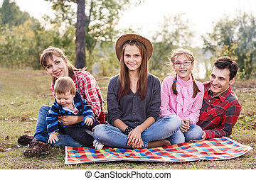 Happy family outdoors - Happy frendly family have a picnic...