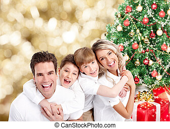 Happy family over Christmas background.
