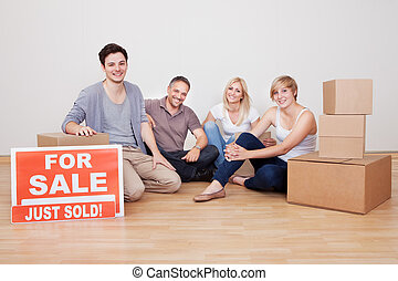 Happy family packing up their home
