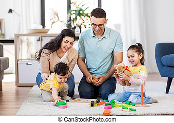 happy family palying with wooden toys at home