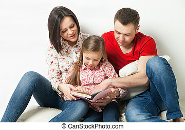 Happy family. Parents reading book with daughter