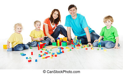 Happy family. Parents with three kids playing blocks