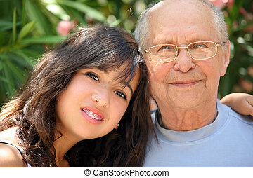 Happy family - Young pretty woman and her grandfather