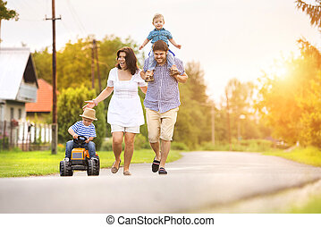 Happy family - Happy young family having fun outside on the...