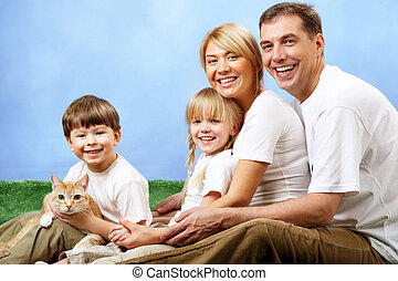 Happy family - Portrait of joyful family and their cute pet...