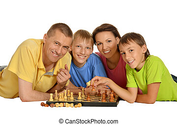 Happy family playing chess