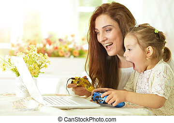 family playing computer game