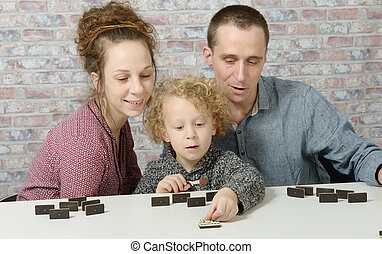 happy family playing dominos