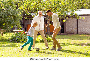 happy family playing football outdoors - family, happiness, ...