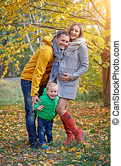 Happy family playing in autumn park