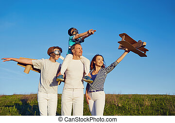 Happy family playing in nature in summer