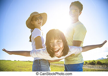 happy family playing on the grass