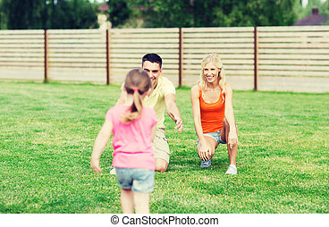 happy family playing outdoors