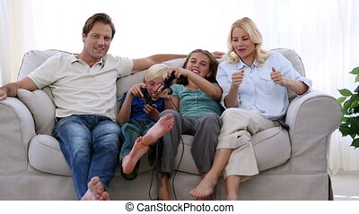 Happy family playing video games at