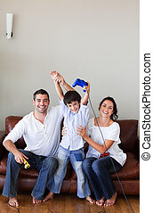 happy family playing video games - Happy family playing...